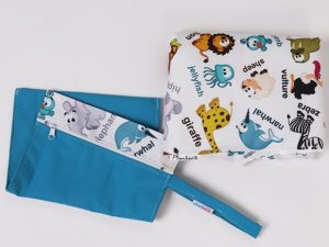 Vrecko na plienky a prebaľovacia podložka - veselé zvieratká vzor